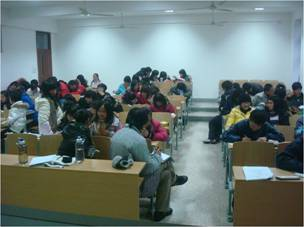 University students at Jiangnan University working on an assignment in class, Wuxi, China